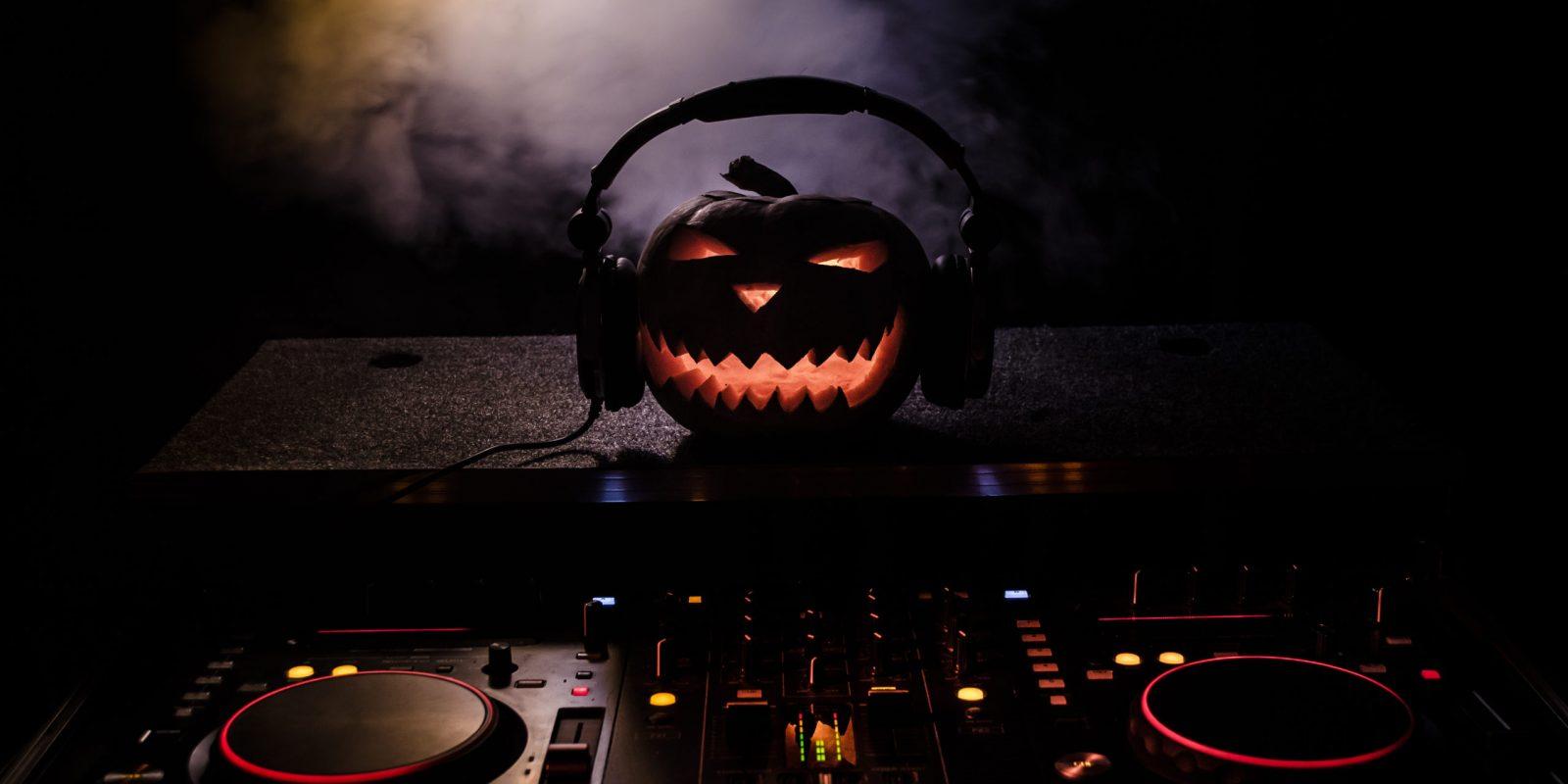 Halloween,Pumpkin,On,A,Dj,Table,With,Headphones,On,Dark